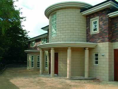 a photo of the front of a new build property called Maybury in hale with a glass domed roof